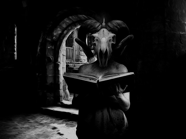 creature reading a book